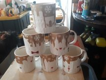 Starbucks gold Christmas relief mugs in Heidelberg, GE
