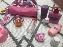 Dolls toy accessories in a bag in Lakenheath, UK