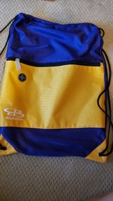 purple and gold drawstring bag in Houston, Texas