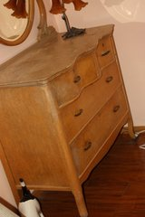 Antique solid wood bedroom dresser with oval mirror-wheels in Alamogordo, New Mexico