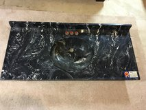 Black cultured marble, single sink, Taylor industries in Fairfax, Virginia