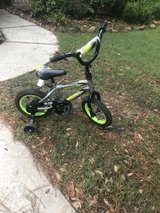 """Huffy 12"""" bike with training wheels in The Woodlands, Texas"""