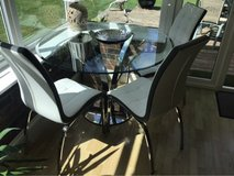 Glass table and set of 4 chairs in Lakenheath, UK