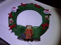 Christmas wreath. teddy bears bows and santa hats in Fort Hood, Texas