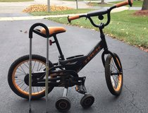 Trek small bicycle with training wheels and training handle in Oswego, Illinois