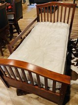 Solid wood twin bed with removable guard rail in Orland Park, Illinois
