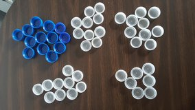 50 Clear and Blue  Plastic Water Bottle Caps Lids in Algonquin, Illinois