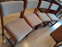 Upholstered dining chairs with casters. in Eglin AFB, Florida