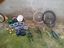 Assorted bike parts and wheels in Alamogordo, New Mexico