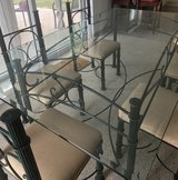 Glass top Iron Dining room table with 6 chairs in Ramstein, Germany