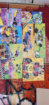 7 Mickey Mouse wooden puzzles with case in bookoo, US
