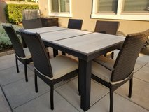 Stone & wicker patio dining table in Travis AFB, California