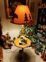 Wooden table with lamp in Alamogordo, New Mexico