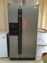 stainless side by side refrigerator works great in Baytown, Texas