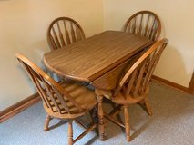 "Solid wood table  with 4 chairswith drop leaf  41"" diameter in Morris, Illinois"