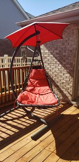 Patio hanging chaise lounger with stand and umbrella. in Joliet, Illinois