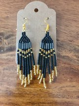 Gold and black beaded earrings in Converse, Texas