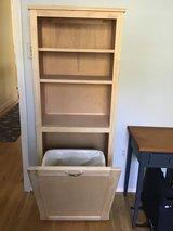 Wood tip-out laundry or trash bin with shelving in Quantico, Virginia