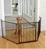 Black tri fold dog or baby gate, greats round fireplace in Yucca Valley, California