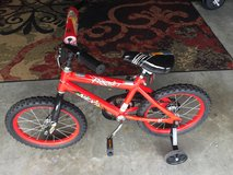 "16"" red rocket bicycle with training wheels in Camp Lejeune, North Carolina"