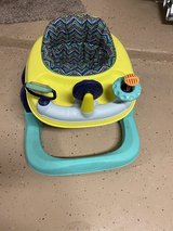 Baby walker with toys on the front for baby to stay occupied-in good condition in Baytown, Texas