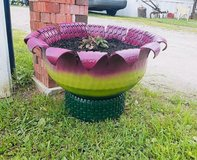 Small flower pot tire planters in Cherry Point, North Carolina