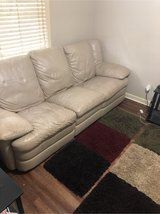 leather couch with recliner on both ends with 2 rugs in Warner Robins, Georgia