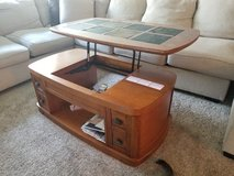 coffee table with lifting top as desk in Joliet, Illinois