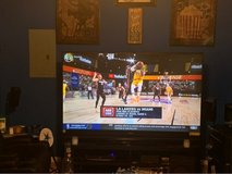 """Mitsubishi 82"""" TV with stand and Panasonic wireless home theatre system in Fort Campbell, Kentucky"""
