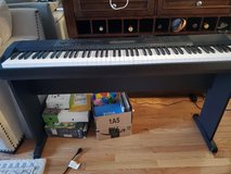 Casio keyboard with stand and chair in Bartlett, Illinois