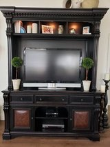 Large Hooker Furniture brand entertainment center in Spring, Texas