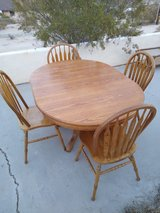 oak dinning table and chairs in 29 Palms, California