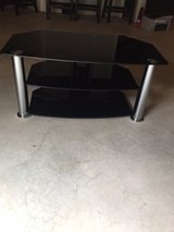 Glass (tinted black) TV stand in Plainfield, Illinois