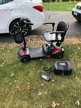 Like new Drive Medical SFSCOUT4 Spitfire Scout 4 Compact Travel Scooter, 4-Wheel, Red/Blue. in Bolingbrook, Illinois