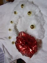 Christmas wreath fluffy white with large red bow and gold ball decorations in Fort Hood, Texas