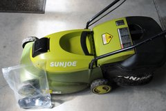 Battery powered lawn mower by Sunjoe in Camp Lejeune, North Carolina