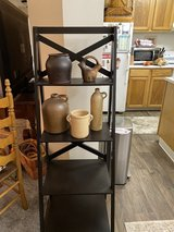 Shelf stand. And very old jugs  sold separately. Moving need to sell soon in Fort Lewis, Washington