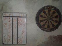 Dart board with darts and dry erase board in Ramstein, Germany