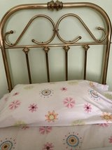 Twin brass headboard in Chicago, Illinois