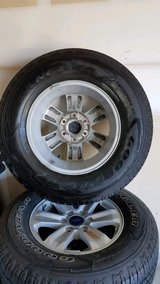 Four Ford rims and tires in Dyess AFB, Texas