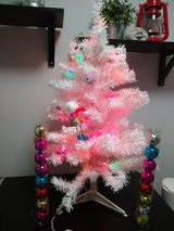 White pre-lit tree - looks pink but thats with the lights on in Orland Park, Illinois