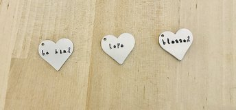 Hand stamped charms in Beaufort, South Carolina