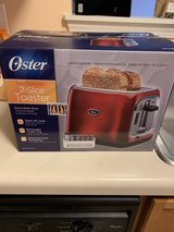 Oster Red Metallic 2 - Slice Toaster in Chicago, Illinois
