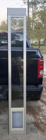 Sliding glass doggy door insert in The Woodlands, Texas