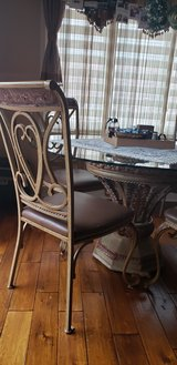 Beautiful glass table with 4 chairs. in Westmont, Illinois
