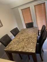 Table and five chairs in Lawton, Oklahoma