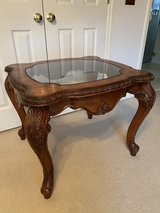 Carved wood end table with glass top in Fort Benning, Georgia