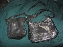 lot of 2-Montana West and Fossil black leather purses in Fort Bliss, Texas