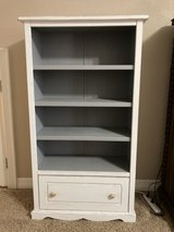 Book case with bottom storage drawer in The Woodlands, Texas