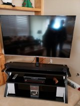 55 inch JVC TV mounted on an iron and glass stand in Camp Pendleton, California